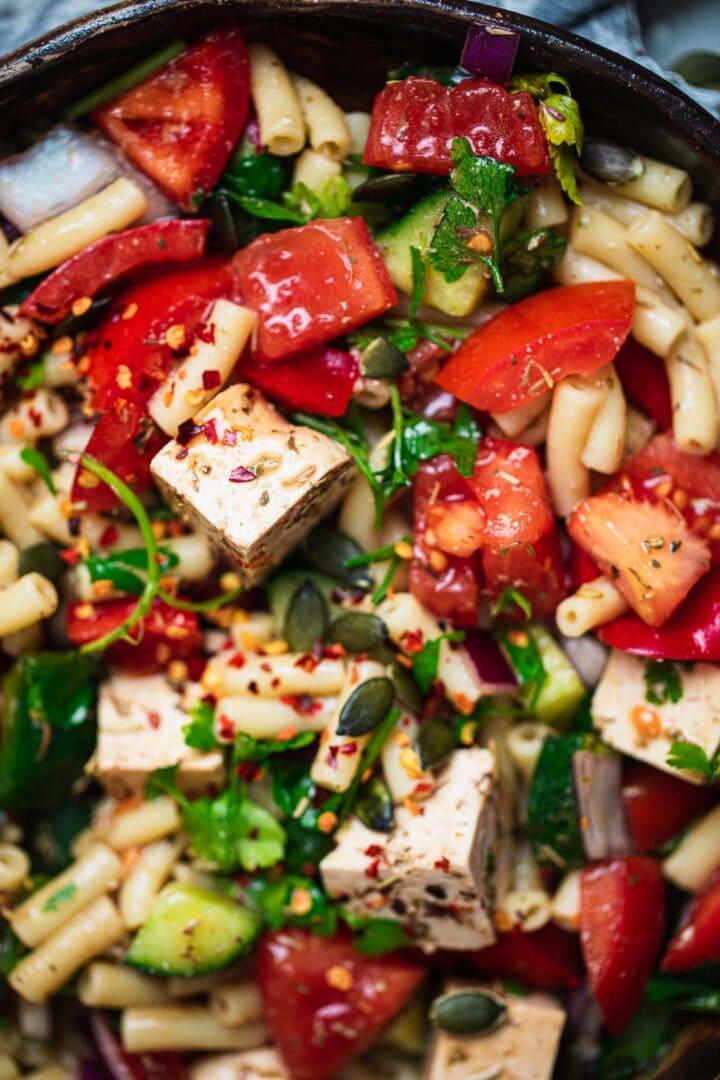 Closeup of a vegan pasta salad with tofu feta