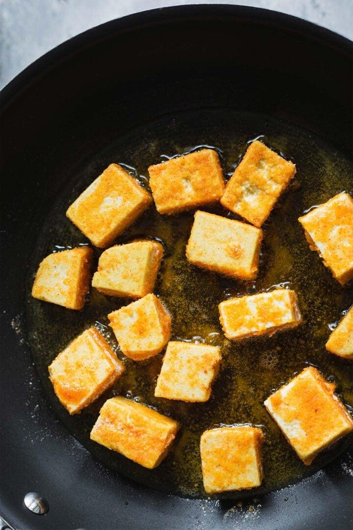 Crispy tofu in a frying pan