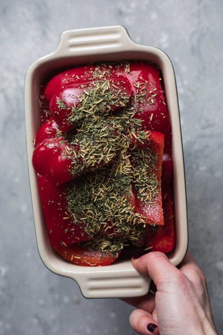 Red peppers and herbs in a baking dish