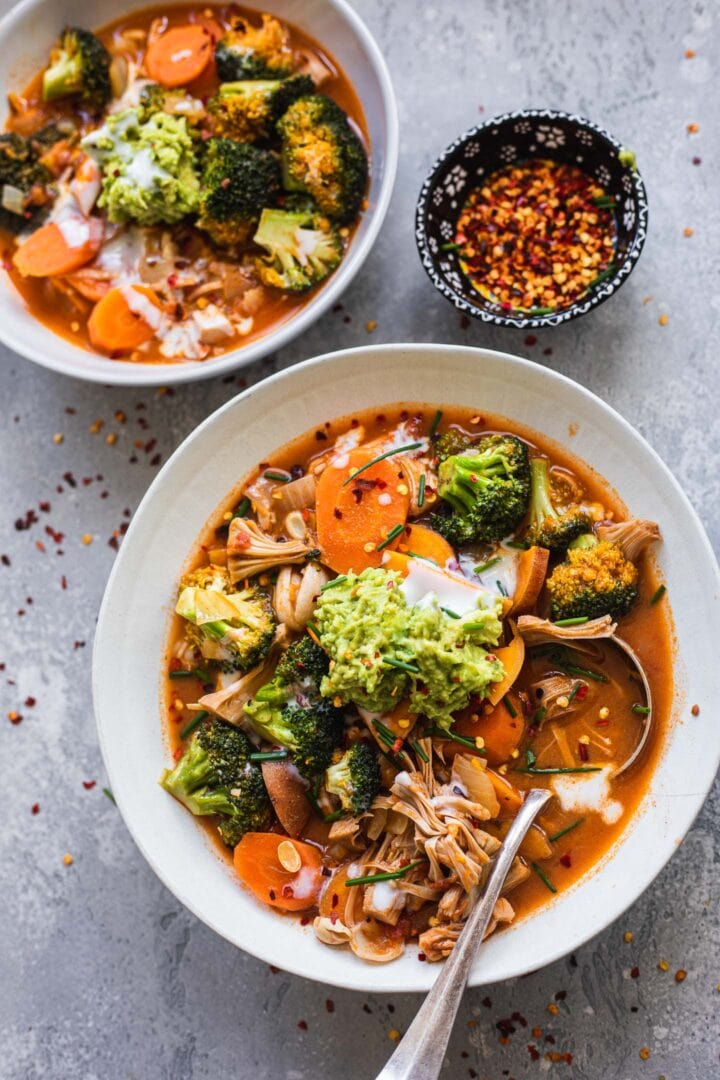 Two bowls of soup with jackfruit, sweet potato and broccoli