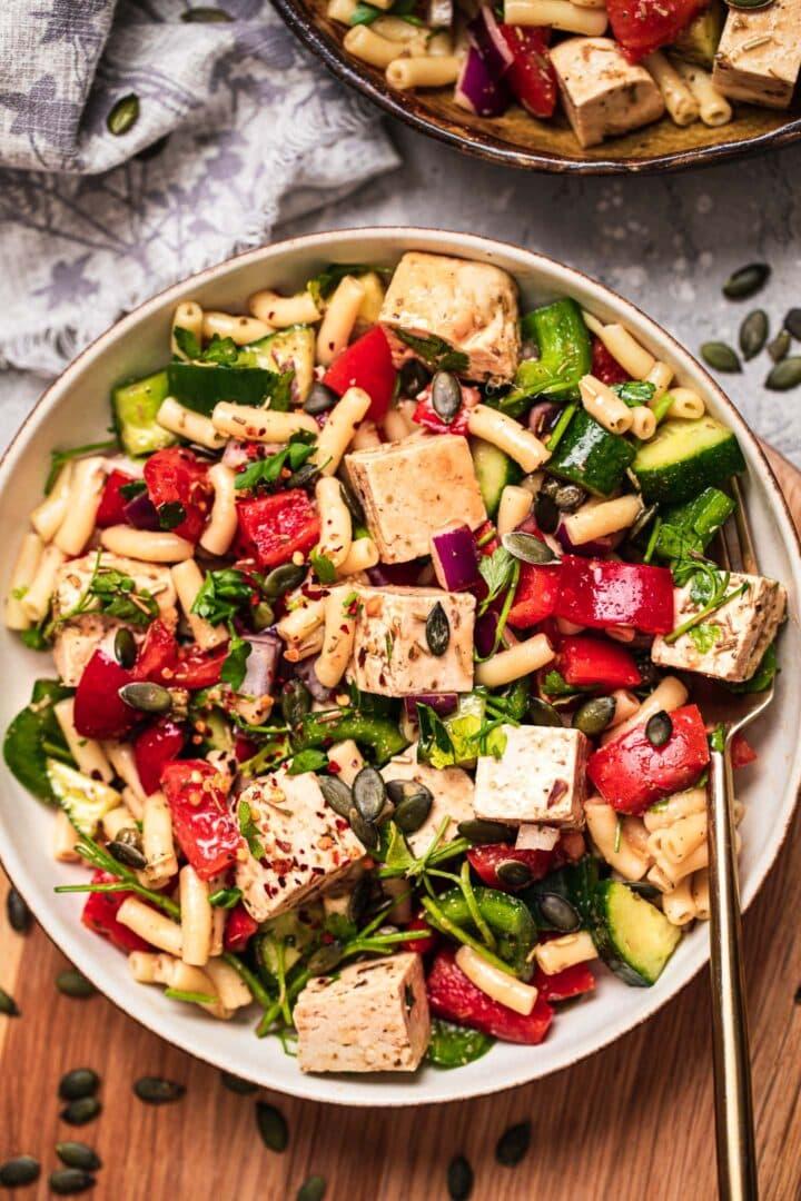 Vegan pasta salad with tofu feta and vegetables