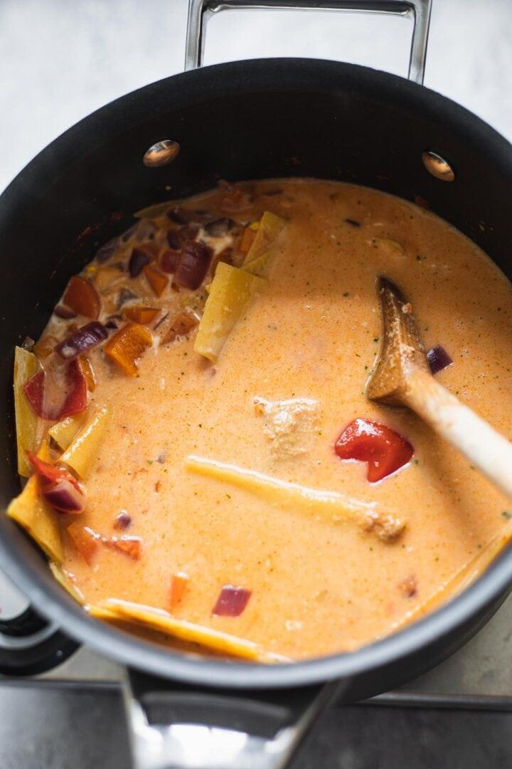 Vegetables and lasagna noodles in a saucepan