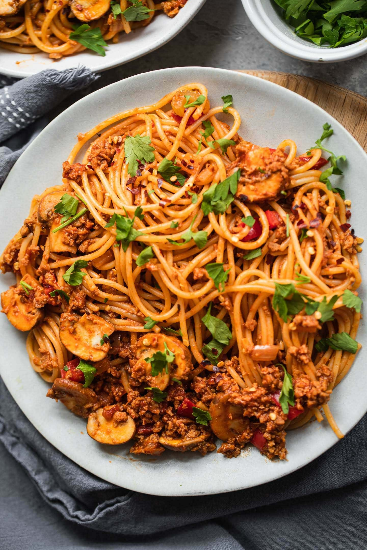 Bowl of plant based spaghetti Bolognese with vegetables in a bowl