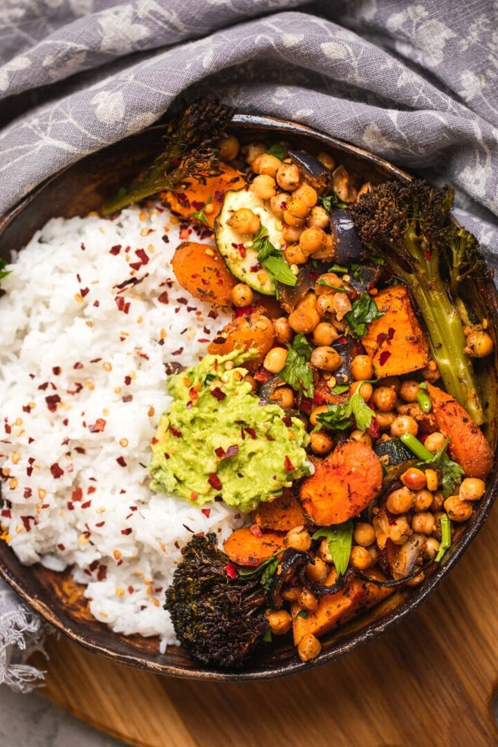 Bowl of roasted chickpeas and vegetables in a bowl