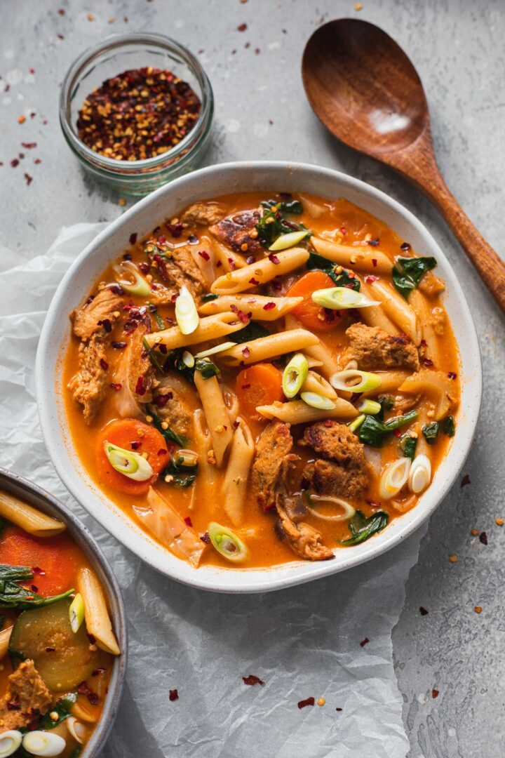 Bowl of vegan soup with plant based chicken and pasta