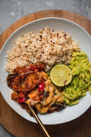 Bowl with vegan Moussaka, avocado and wholegrain rice