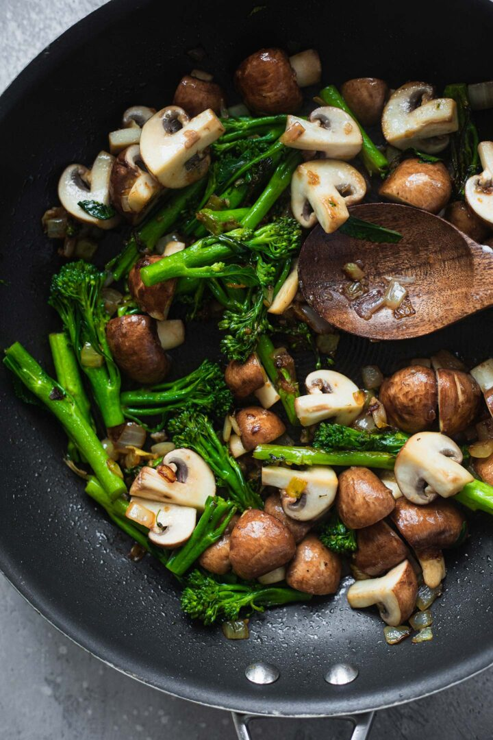 Broccoli and mushrooms in a frying pan