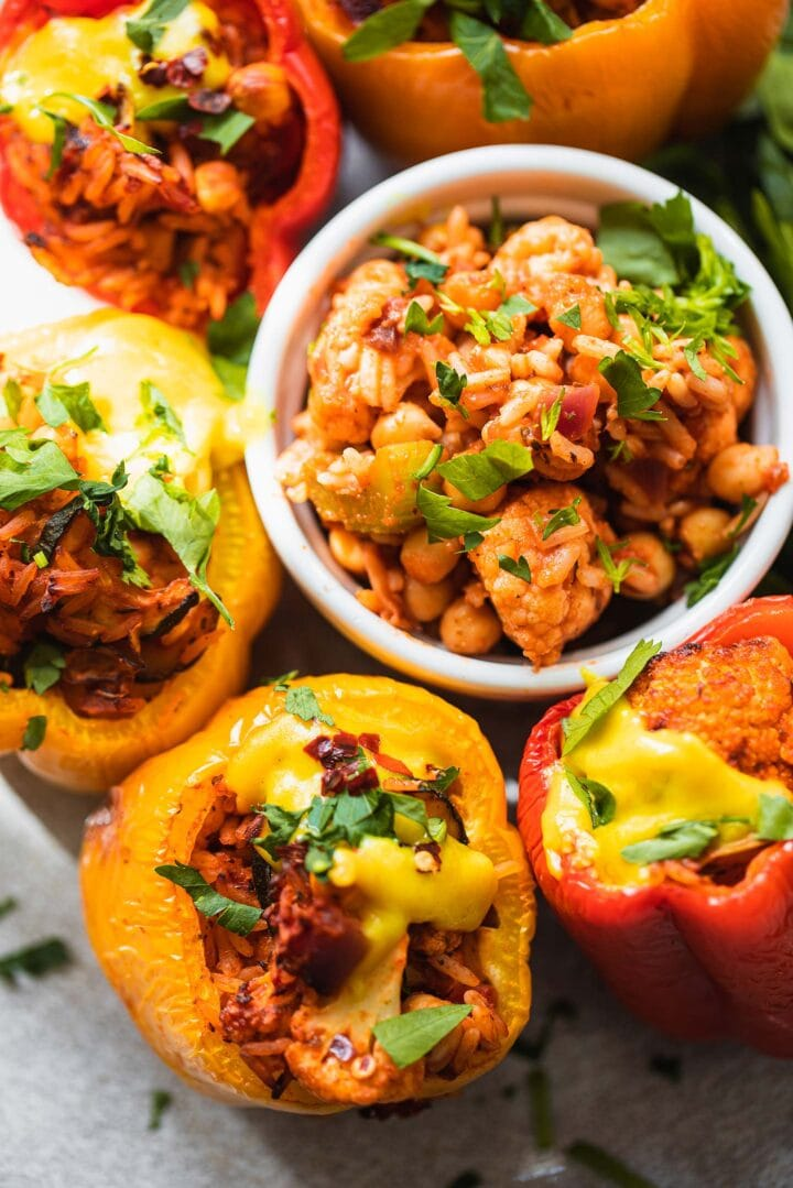 Closeup of vegan stuffed peppers with a cheesy sauce