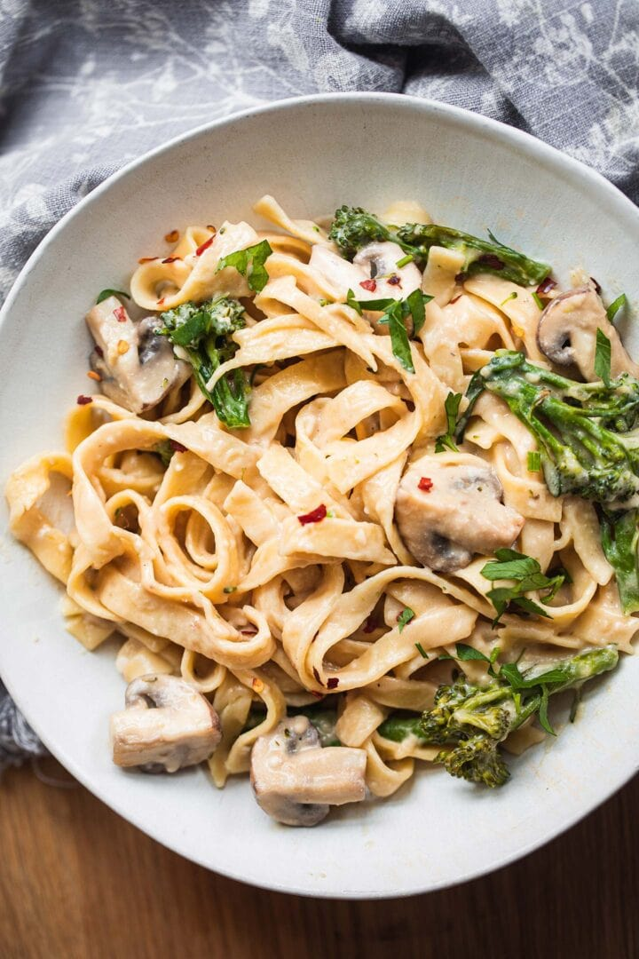 Fettuccini in a bowl with broccoli and mushrooms