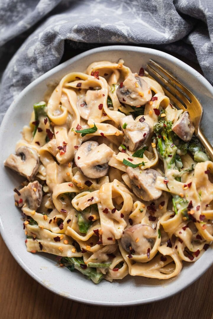 Pasta with broccoli and mushrooms in a bowl