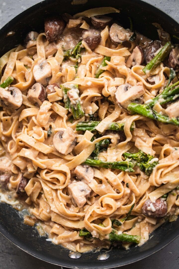 Pasta with broccoli and mushrooms in a frying pan