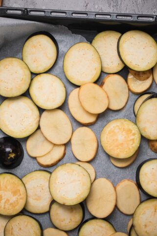 Potatoes and eggplant on a baking tray