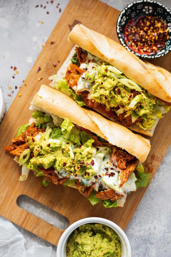 Sandwiches with vegan chicken, avocado and soy yoghurt dressing