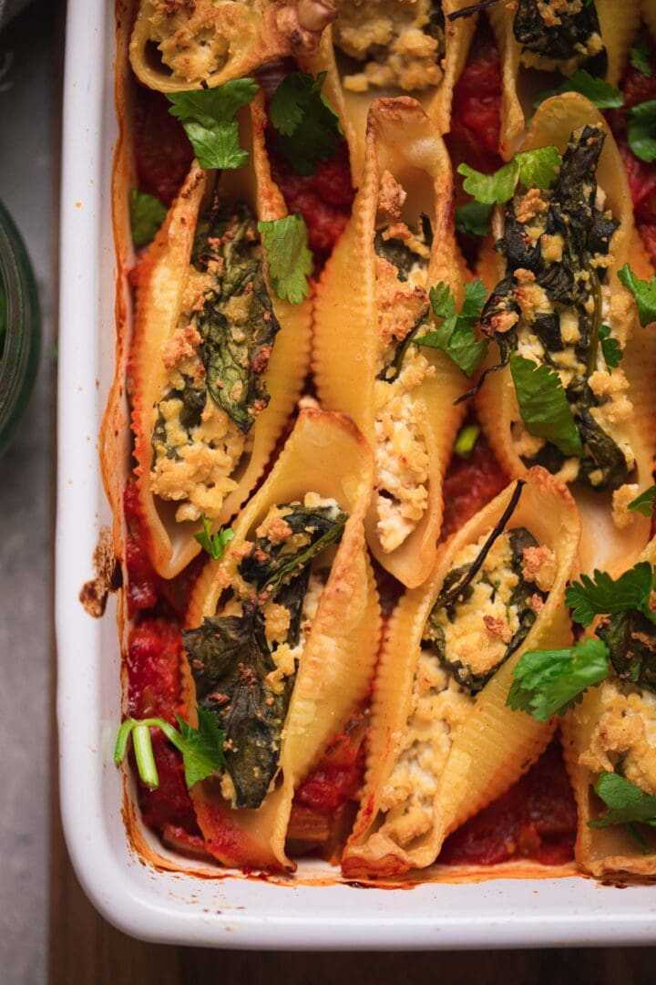 Stuffed shells with dairy-free tofu ricotta in a baking dish