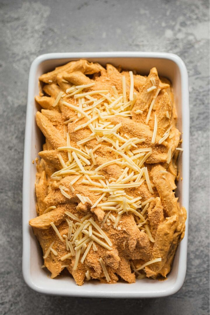 Vegan cheesy pasta with breadcrumbs in a baking dish
