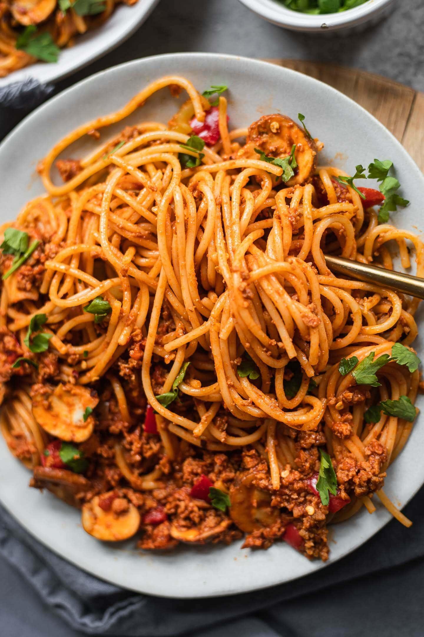 Vegan spaghetti dish with a tomato vegetable sauce