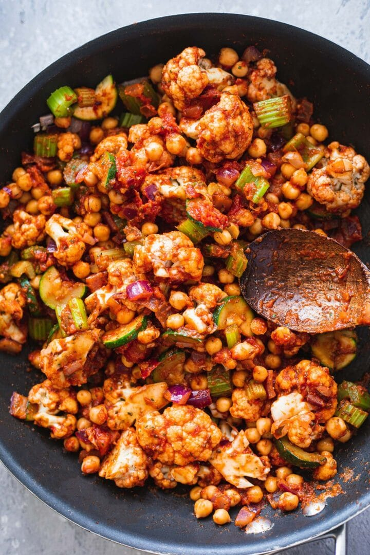 Vegetables and chickpeas in a frying pan