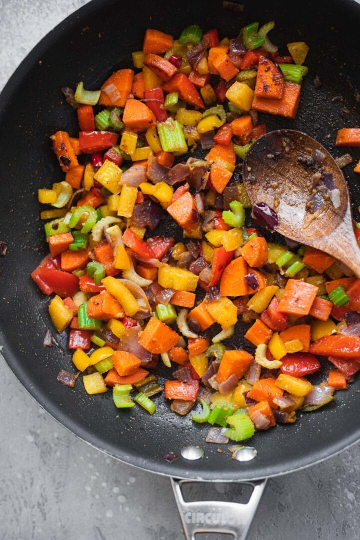 Vegetables and spices in a frying pan