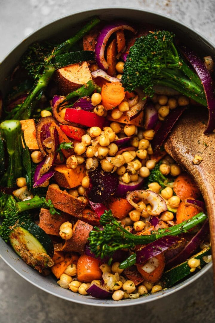Vegetables, chickpeas and sweet potatoes in a mixing bowl