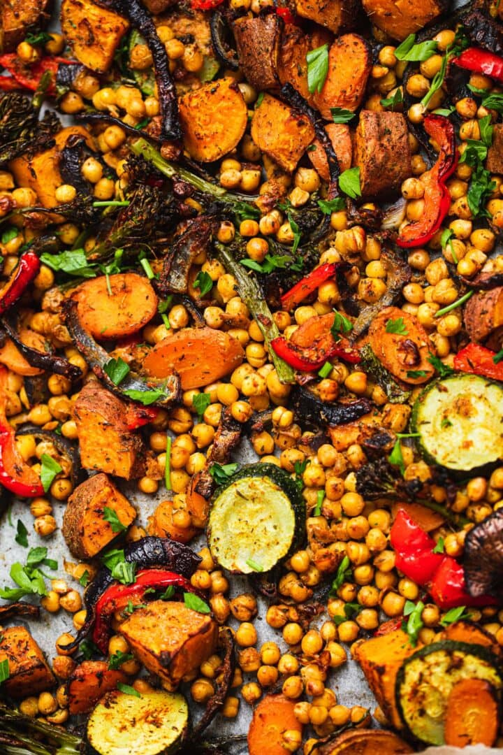 Vegetables, sweet potatoes and chickpeas on a baking tray