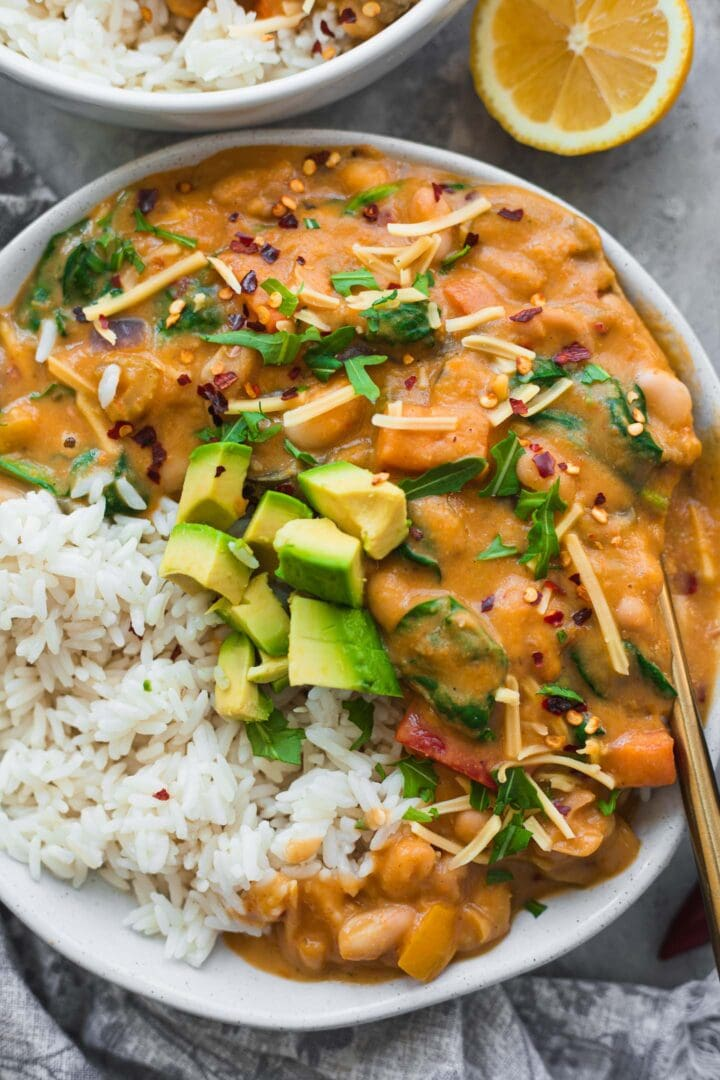 Vegetarian chili with avocado and rice in a bowl