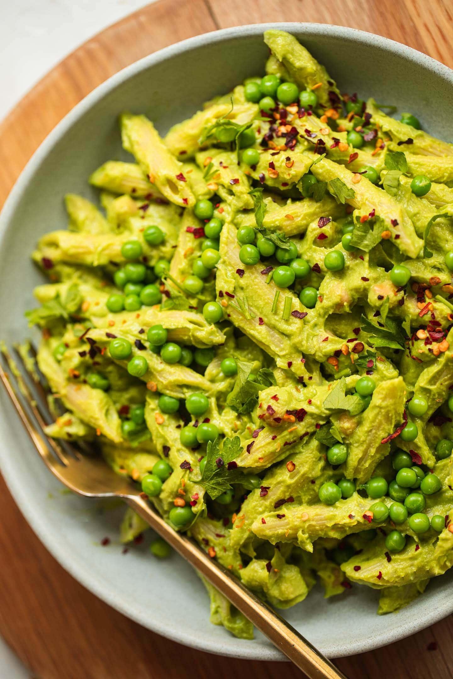 Bowl of vegan pasta with an avocado sauce