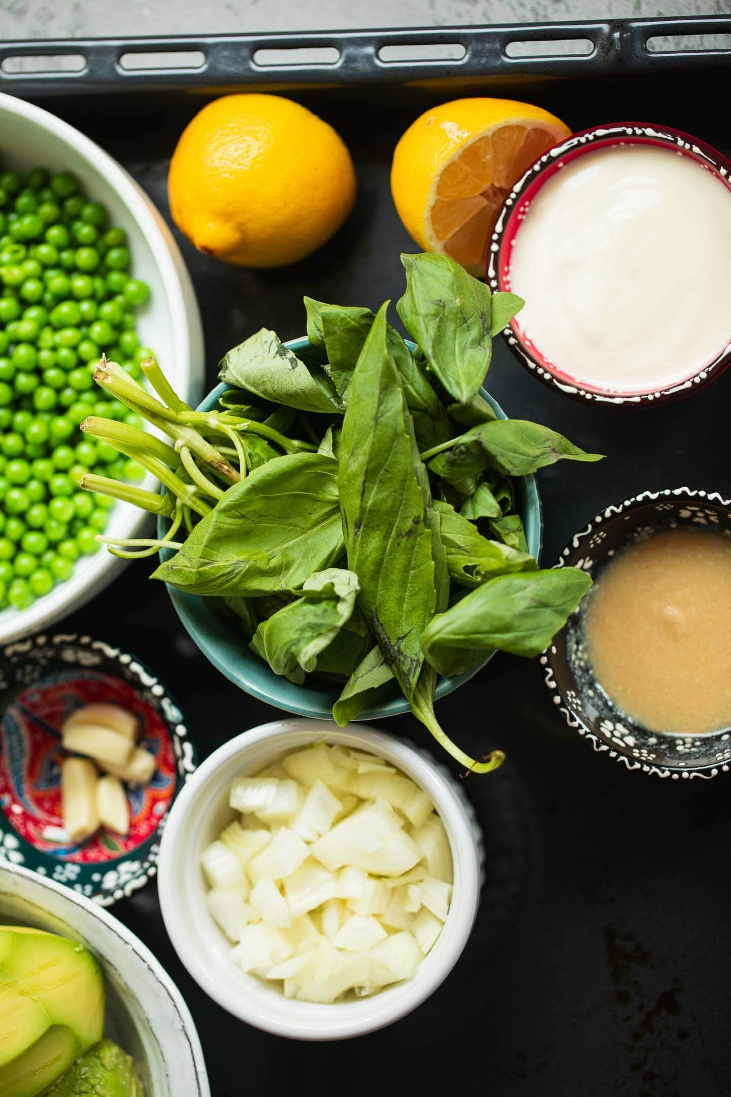 Ingredients for pea and avocado pesto pasta