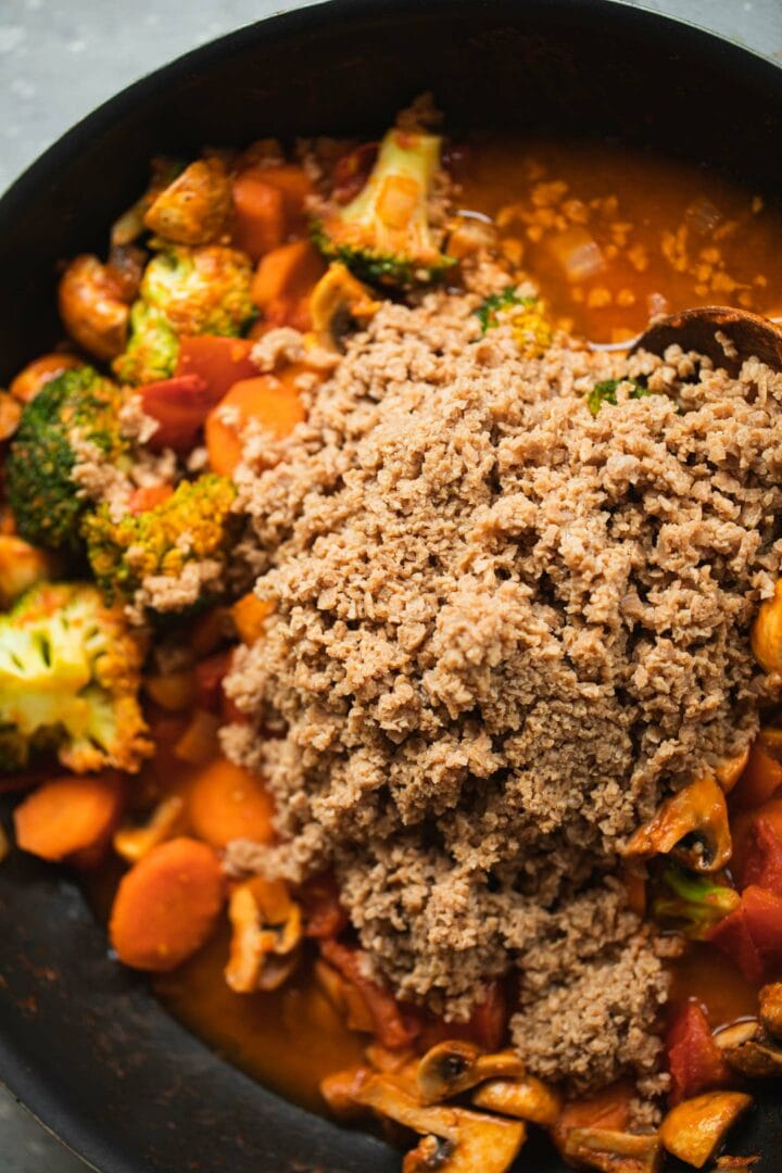 Stew with soy mince in a frying pan