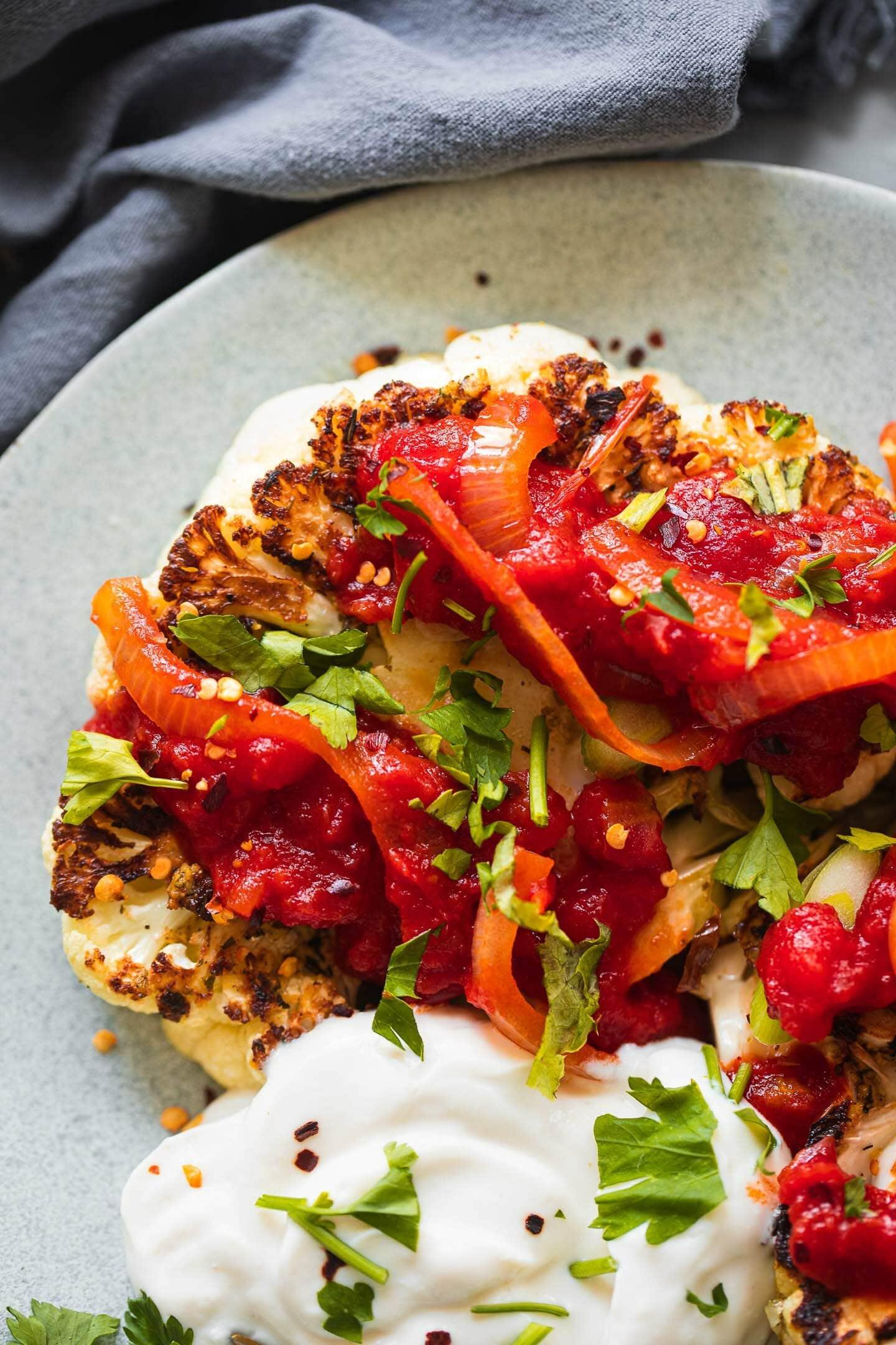 Vegan cauliflower steak with tomato sauce and soy yoghurt