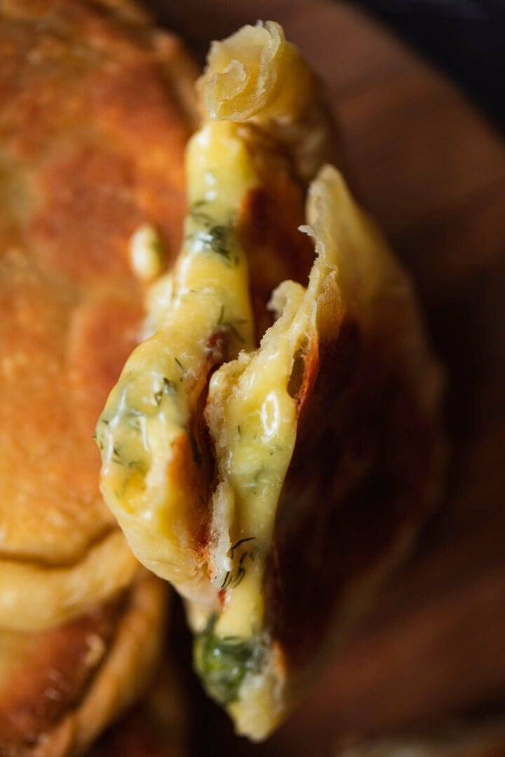 Closeup of a vegan pirozhok with cheese