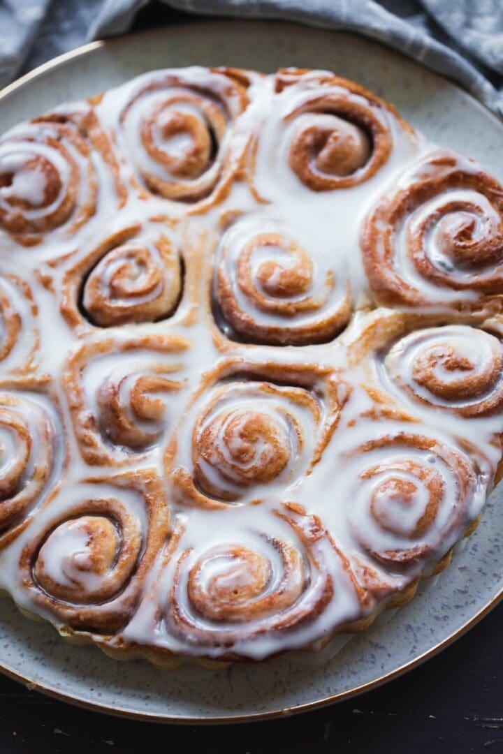 Easy cinnamon rolls on a plate with an icing sugar glaze