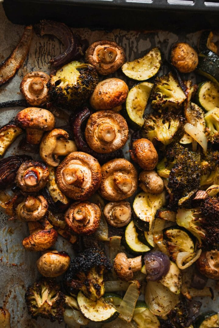 Mushrooms, zucchini and onions on a baking tray
