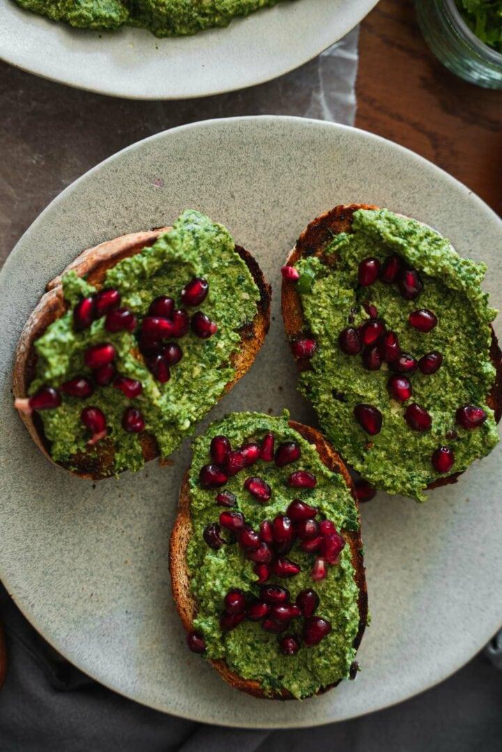 Pkhali and pomegranate seeds on toast