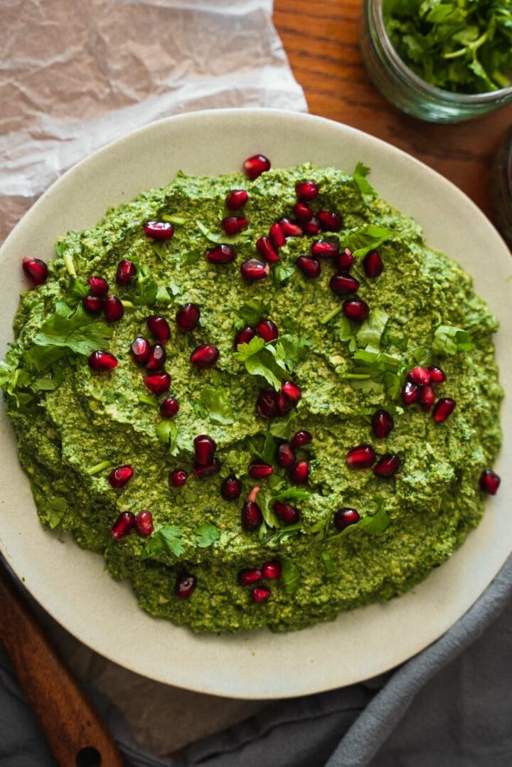 Plate of Georgian spinach spread with pomegranate seeds