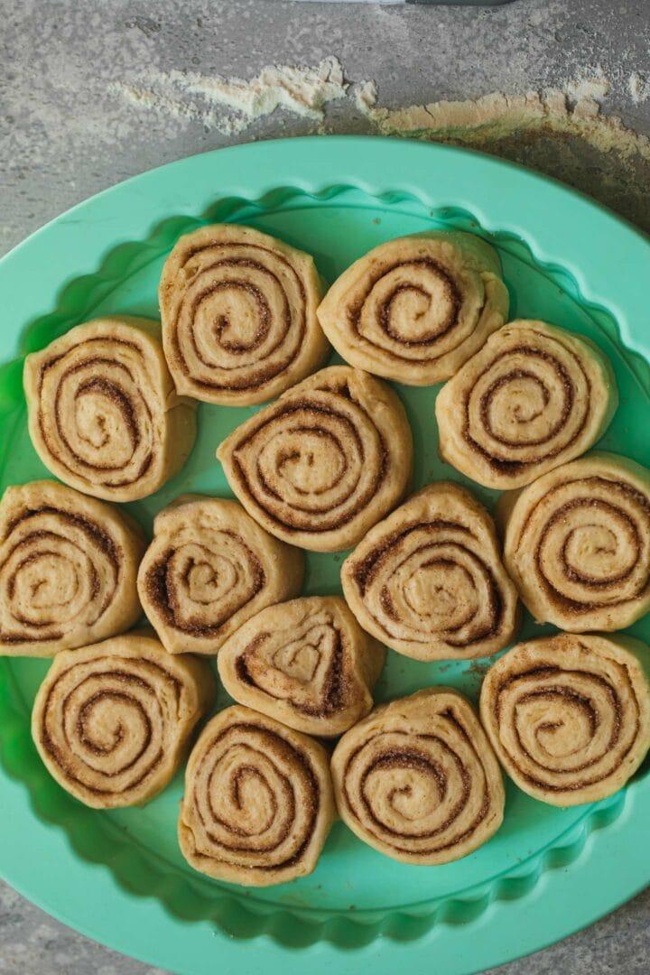 Vegan cinnamon rolls in a baking tray before baking