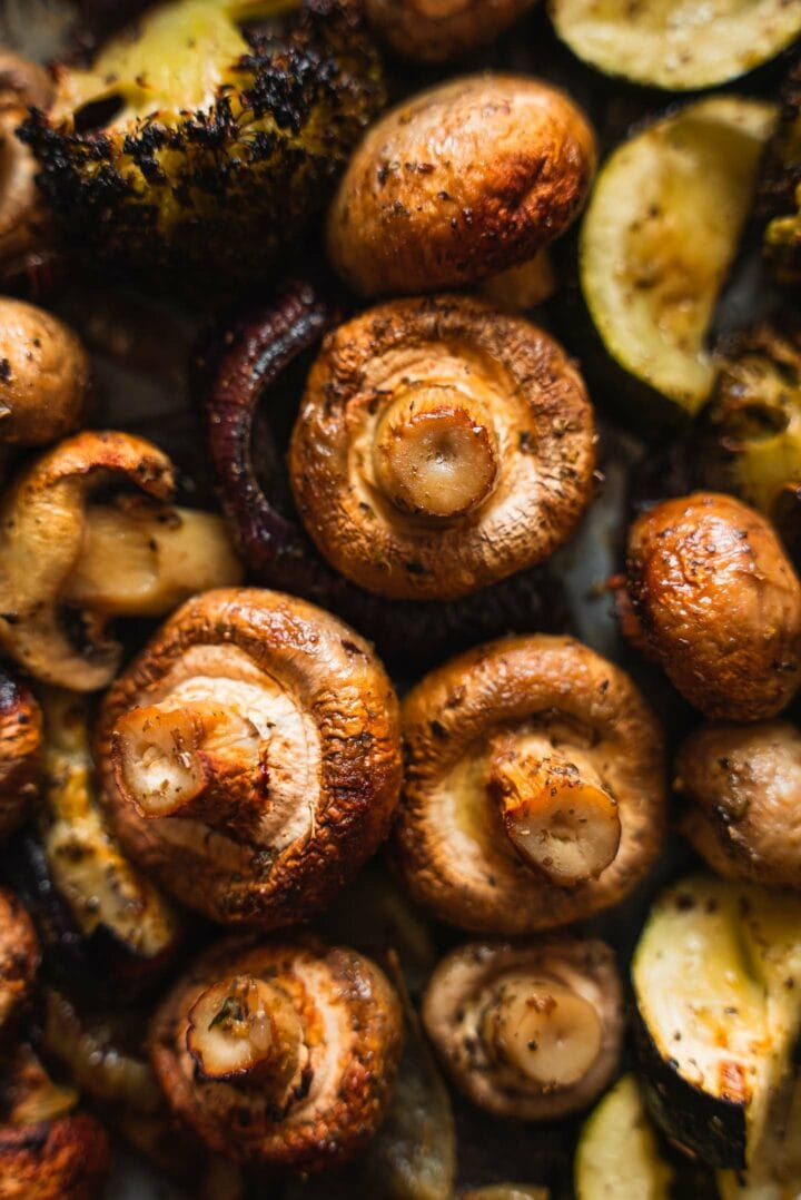 Zucchini and mushrooms on a baking tray