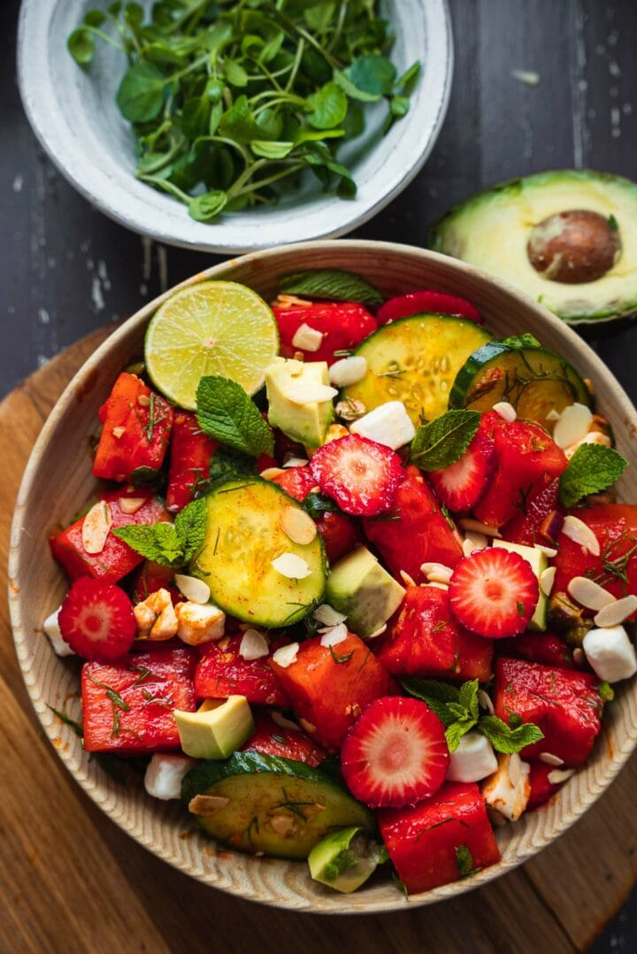 Bowl of vegan salad with watermelon and cucumber