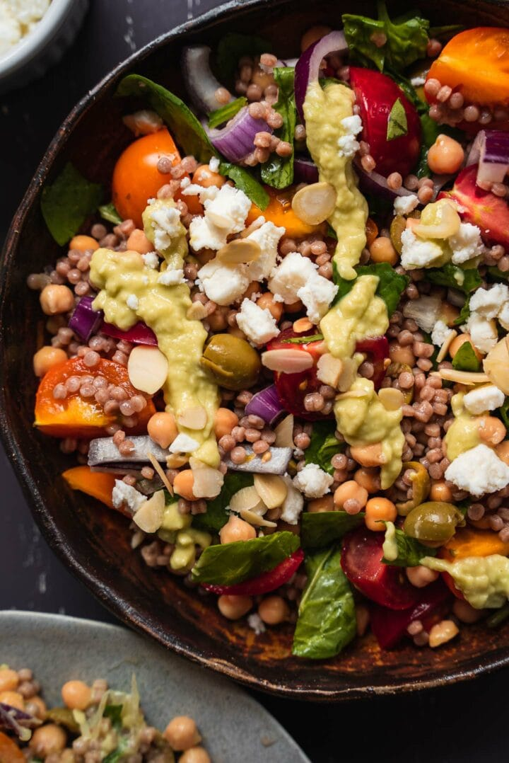Closeup of vegan salad with feta and vegetables