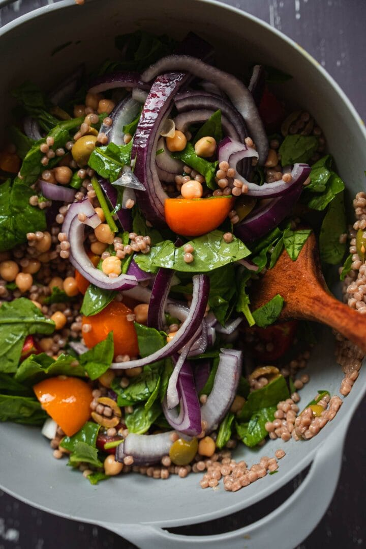 Couscous salad in a mixing bowl