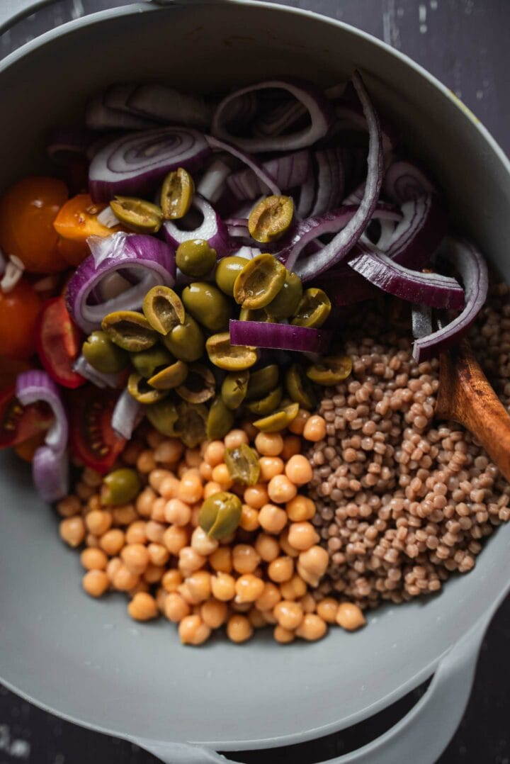 Couscous salad ingredients in a mixing bowl