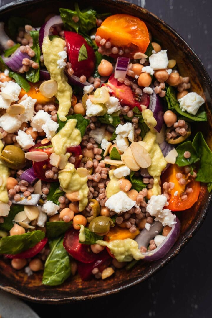 Couscous salad with tomatoes, onions and vegan feta