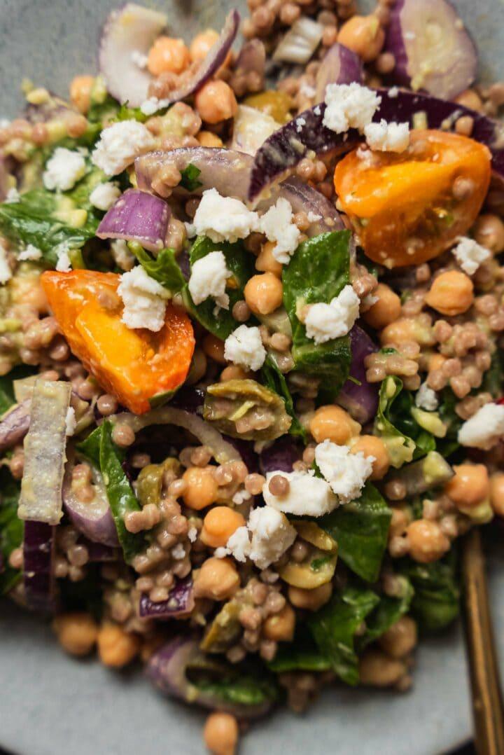 Couscous salad with vegan feta and avocado sauce