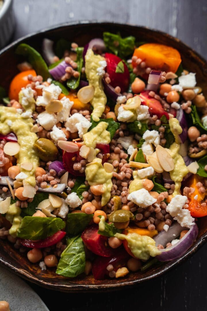 Vegan salad with couscous, vegetables and avocado dressing
