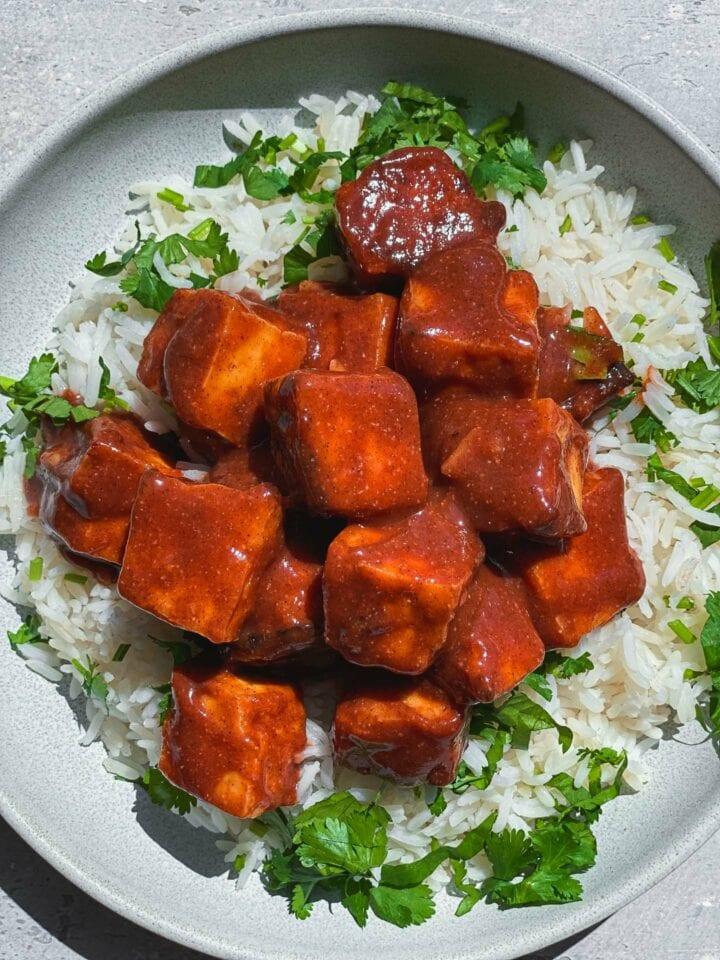 Bowl of BBQ tofu over rice