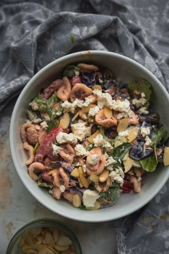 Bowl of pasta salad with cream cheese and vegetables