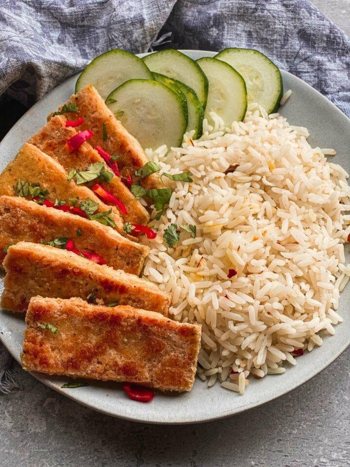 Crispy tofu and rice on a plate