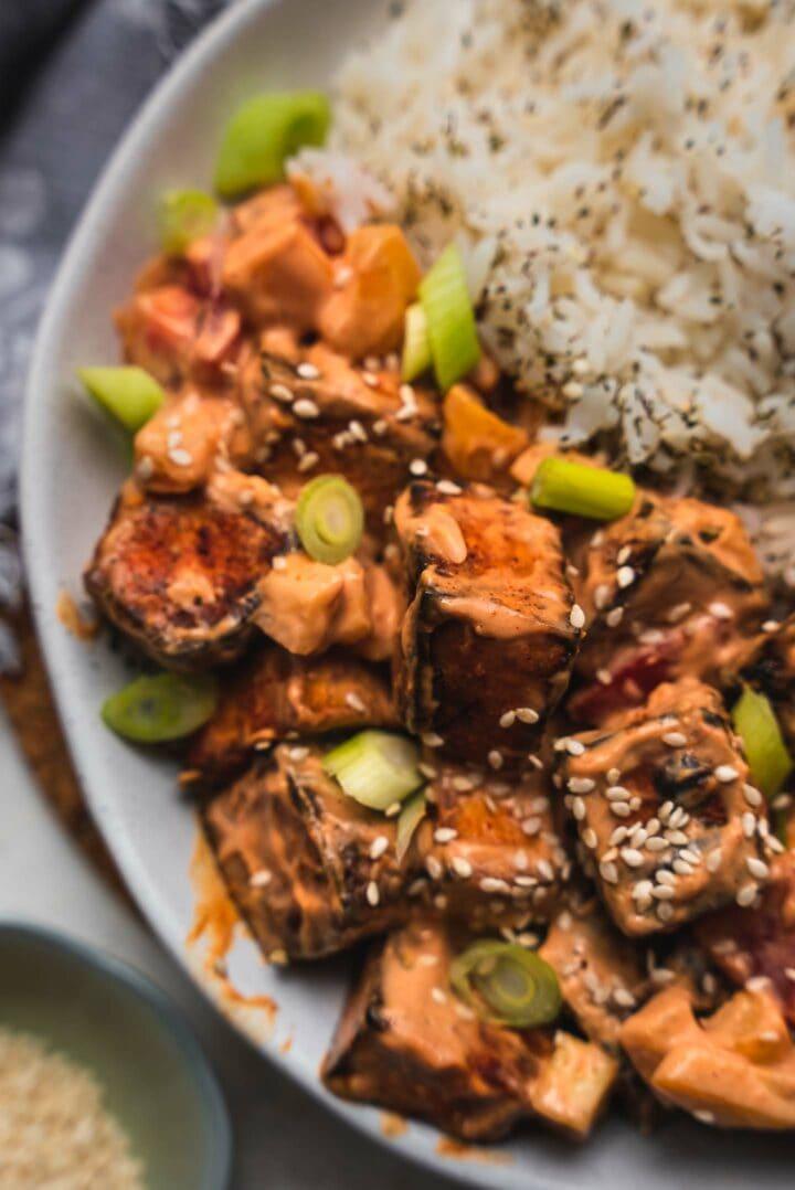 Crispy tofu with peanut sauce in a bowl