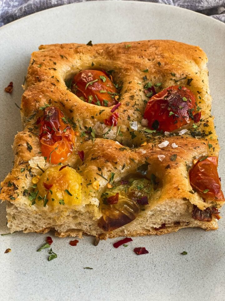 Slice of focaccia with tomatoes