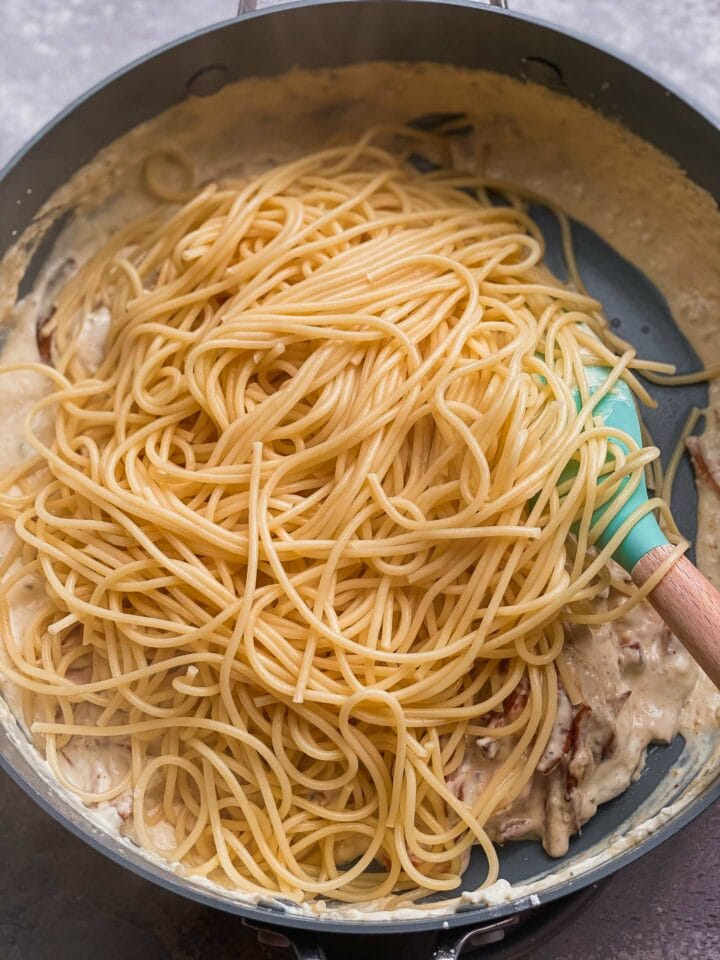 Spaghetti and a dairy-free sauce in a frying pan