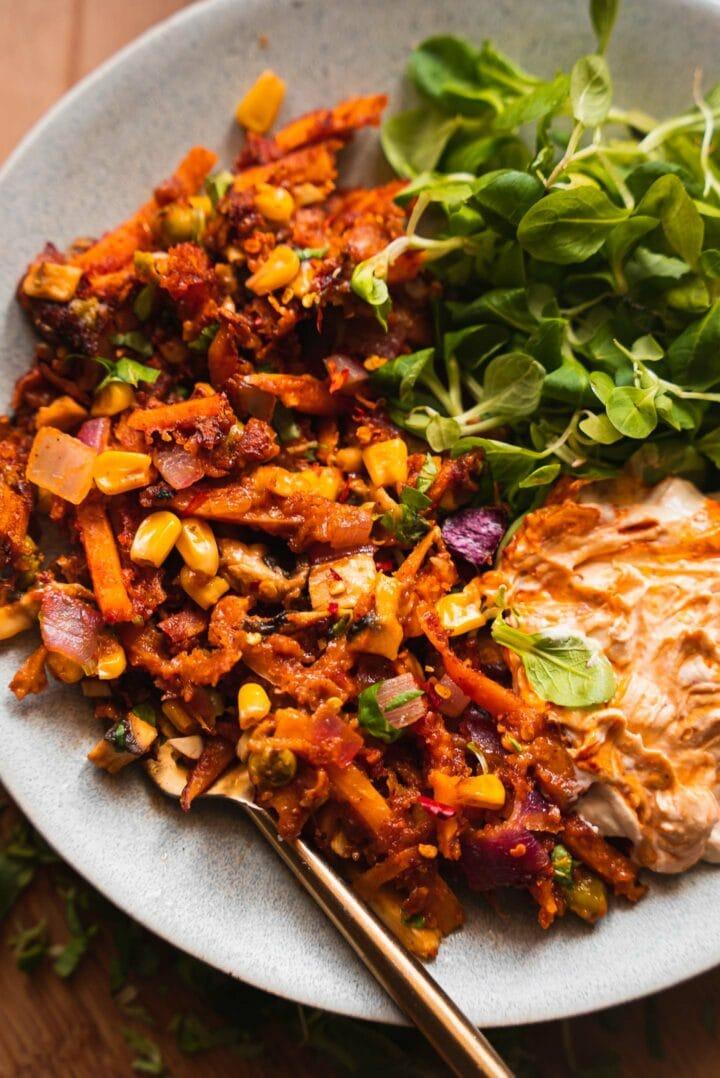 Sweet potato hash with peas, sweetcorn and salad